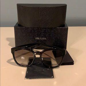 Prada black sunglasses with silver toned hardware